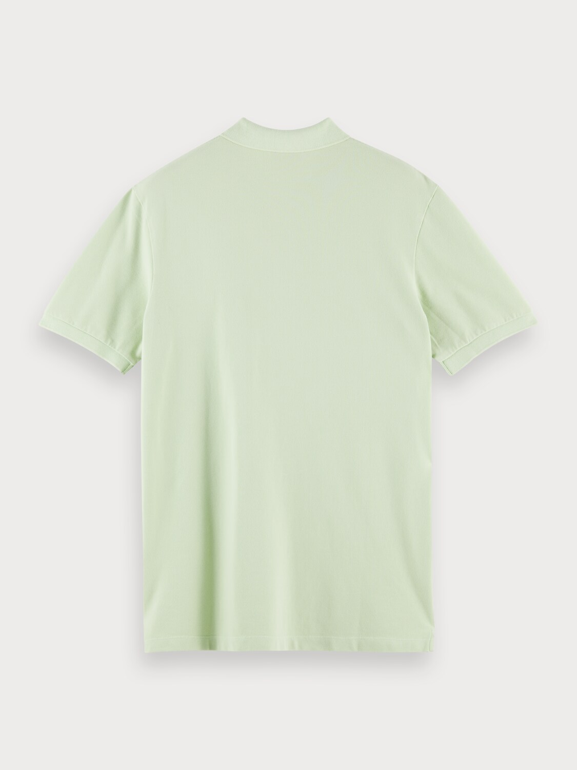 Organic cotton garment-dyed pique polo with washing